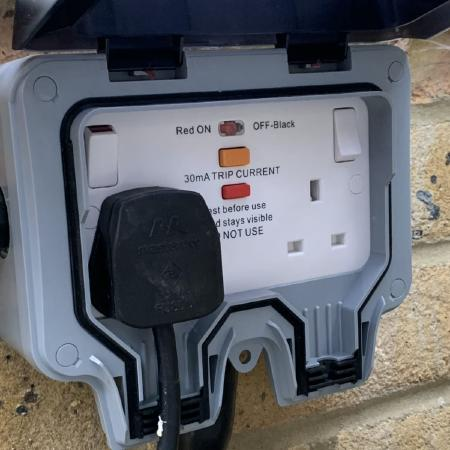 Mains socket with integrated RCD.