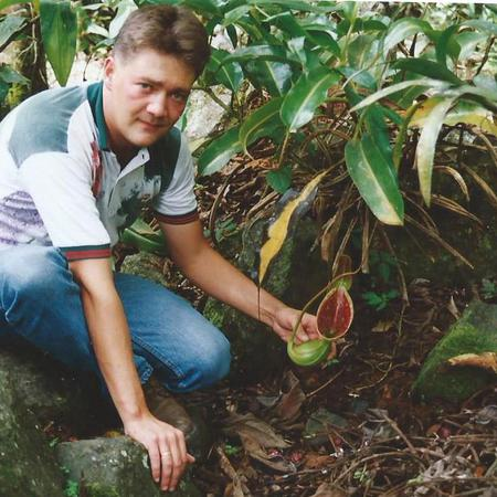 Matt with Nepenthes lowii on Mount Kinabalu, Borneo.